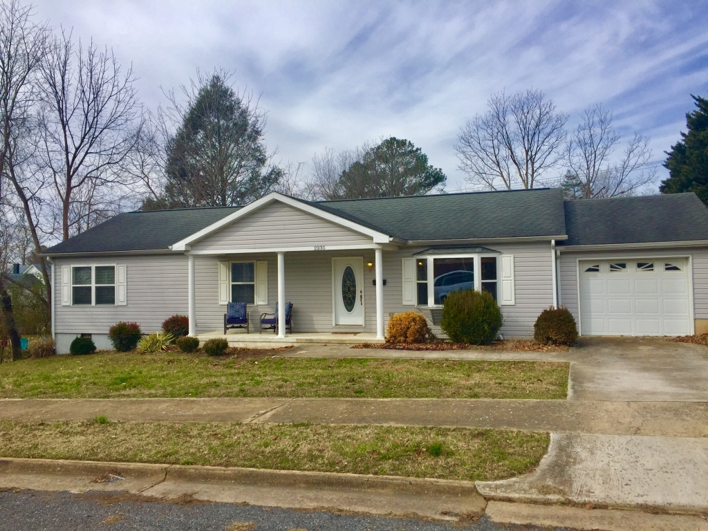 Location, Location, Location!! Move-in Ready. 3 bedrooms, 2 baths, Open kitchen, dining, attached garage, Huge rear deck and fenced back yard. Covered front porch with lovely Mountain Views. Walking distance to SVU.